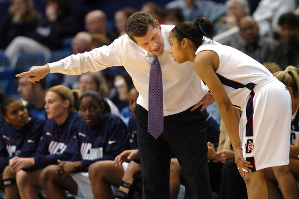Sophomore Ketia Swanier takes some direction from UConn coach Geno Auriemma during the Huskies' 71-60 win over Notre Dame in a Big East quarterfinal game on March 5, 2006. It was senior Barbara Turner who led the way with 19 points, but sophomore Ketia Swanier who provided the spark. Swanier came off the bench to score 11 in the win and UConn went onto defeat West Virginia for the title two nights later.