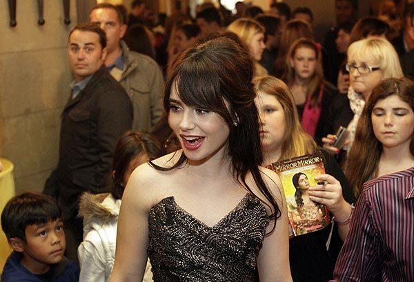 "Lily Collins is surrounded by her young fans at a party after the premiere of ""Mirror Mirror.""  Collins, the daughter of singer Phil Collins, has her first leading role as Snow White in the film."