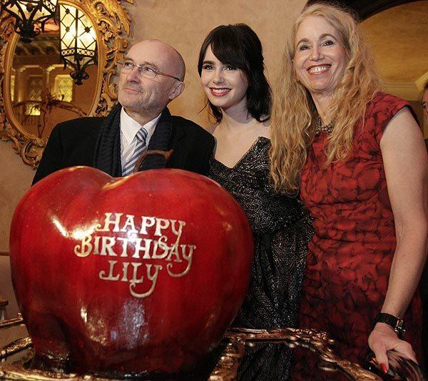 Lily Collins with her father, Phil Collins, and her mother, Jill Tavelman.
