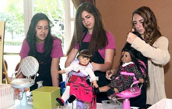 Shasha Alejo, Victoria del Valle, and Katherine Simone at the doll hair styling booth at the American Girl Fashion Show fundraiser hosted this month by the Flintridge Guild of Children's Hospital Los Angeles. The three-day event drew 1200 guests.
