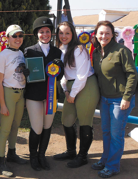 From left, C.J. Giacomini, Jessica Middleberg, Allie Veach and hunt seat team coach Gina Hall recently went to the regional competition of the International Horse Show Association, representing Wilson College.