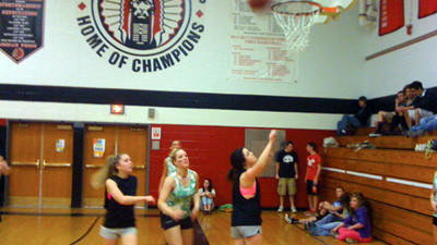 Sophomore Alyson Shroyer, junior Alexia Frasier and sophomore Jordan Rich compete for a rebound at Conemaugh Township Area School District's annual fundraising basketball tournament for the American Heart Association.