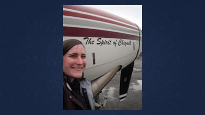 Kasie Pletcher, a graduate of Rockwood Area High School, is pictured by her daily mode of transportation:an airplane. Plectcher soars above the Alaskan landscape in the The Spirit of Chignik to work at area schools each Monday.