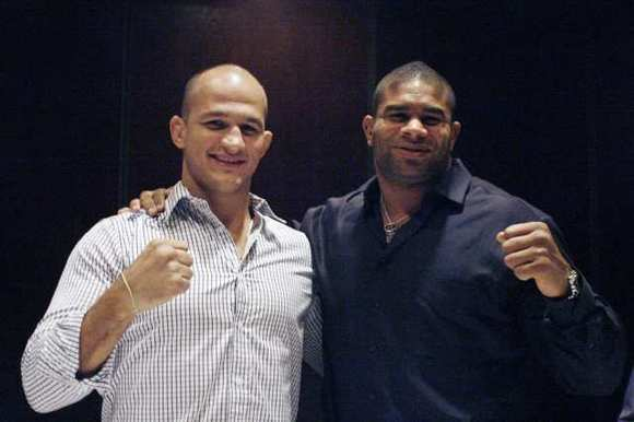 UFC heavyweights Junior Dos Santos, left, and Alistair Overeem pose for the camera after a press conference, which took place at Morton's Steakhouse in Burbank on Wednesday.