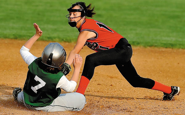 North Hagerstown's Laken Feeser, right, slaps the tag on South Hagerstown's Shayna Bickford as she slides into second base on Wednesday during the Hubs' 10-0 win.