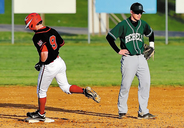 South Hagerstown's Ryan Barton, right, shows his disappointment as North Hagerstown's C.J. Owings rounds the bases after his fifth-inning home run on Wednesday during the Hubs' 14-4 victory.