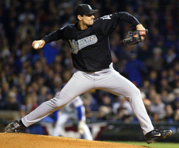 Florida Marlins starter Carl Pavano delivers a pitch to Chicago Cubs batter Sammy Sosa during the first inning of play in Game 6 of their NLCS Championship series at Wrigley Field in Chicago, October 14, 2003