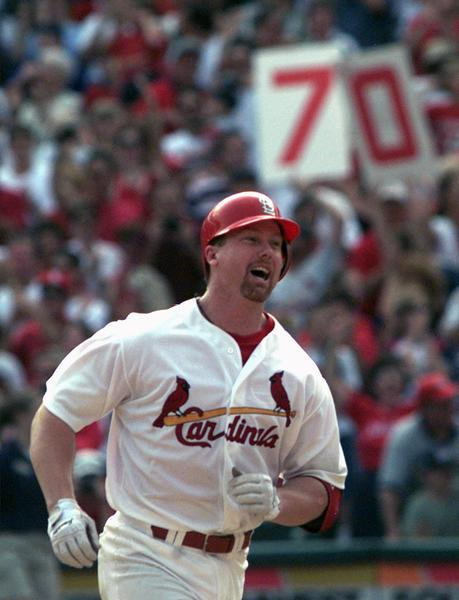 St. Louis Cardinals slugger Mark McGwire smiles after hitting his 70th home run of the season off Carl Pavano. Pavano was pitching for the Expos in this game on Sept. 27, 1998.