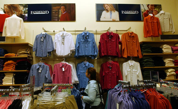 Sears, which bought Lands' End in 2002 and has carried its clothes in its stores, may be considering selling the retailer. A shopper visits the Land's End store within Chicago's State Street Sears store in 2004.