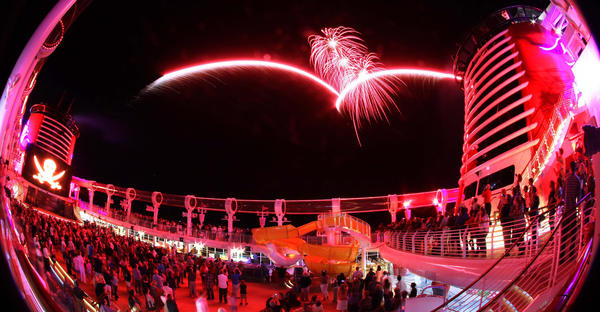 Framed by the AquaDuck water slide, fireworks launch over the pool deck aboard Disney's Fantasy, at sea in the Bahamas, during the Buccaneer Blast party, late Tuesday, March 27,  2012. The photo was shot with an 8mm super-fisheye lens.
