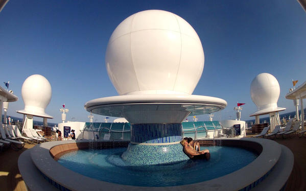 The Satellite Falls fountain/pool in the forward of the ship aboard Disney's Fantasy, at sea in The Bahamas, Wednesday, March 28,  2012.