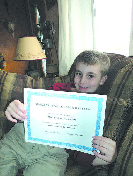 "Matthew Munson holds the ""Golden Table"" certificate he received at Maugansville Elementary School."