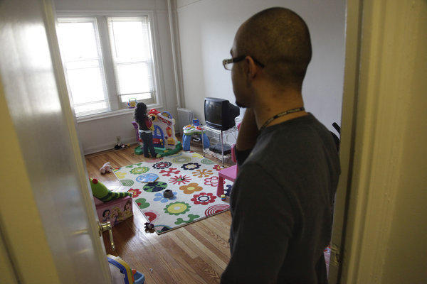 Christopher Astacio stands in the doorway watching as his daughter Cristina, 2, recently diagnosed with a mild form of autism, plays in her bedroom. A new study found the autism rate is on the rise again.