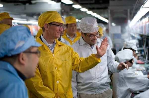 Apple Chief Executive Tim Cook, center left, visits the iPhone production line at the newly built Foxconn manufacturing facility at Zhengzhou Technology Park in China this week.