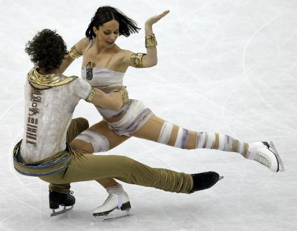 Bronze medalist ice dancer Nathalie Pechalat of France dressed appropriately as a mummy for an event in which the world meet results were mummified in an earlier dynasty.