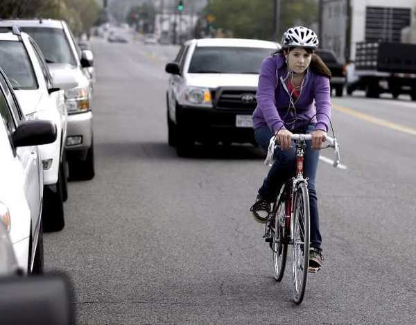 A cyclist rides south on the 700 block of Sonora Avenue in Glendale. The city's Bicycle Transportation Plan would add colored bike lanes and new routes.
