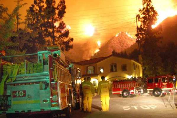 A fire blazes down the mountain at Starlight Crest near Angeles Crest.