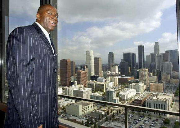 Magic Johnson is at ease in the spotlight, unlike Frank McCourt.