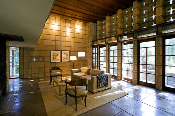 That classic Frank Lloyd Wright move -- the low ceiling -- leads from the entry to the airy living room. A blending of traditions can be seen in the way the concrete blocks are juxtaposed with the finely detailed redwood ceiling, doors and windows. Wright arranged the perforations in the blocks to create a concrete shell that feels lighter than it actually is.