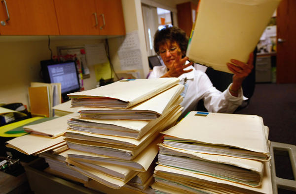 Clinic office assistant Joan Vest searches for a patient's mssplaced medical file at the Spanish Peaks Family Clinic on August 5, 2009 in Walsenburg, Colorado.
