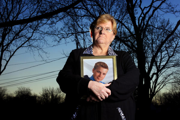 Nanci Koschman holds a picture of her son David, then 18, outside her Mount Prospect home in January.