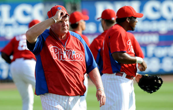 Philadelphia Phillies manager Charlie Manuel watches the morning work out at Bright House Field Thursday morning prior to their game with the Tampa Bay Rays.