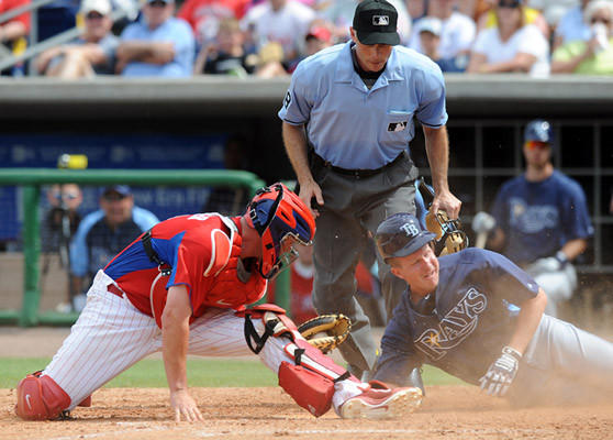 Philadelphia Phillies catcher Brian Schneider (23) left, tags out Tampa Bay Rays' Elliot Johnson (9) at home plate in the bottom of the eighth inning at Bright House Field in Clearwater FL, Thursday afternoon.