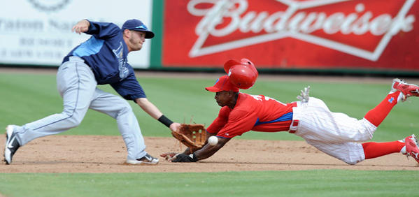 Philadelphia Phillies Juan Pierre (29) right, slides safely into second base a head of the tag from Tampa Bay Rays' SS Reid Brignac (15) left, in the bottom of the eighth inning at Bright House Field in Clearwater FL, Thursday afternoon.