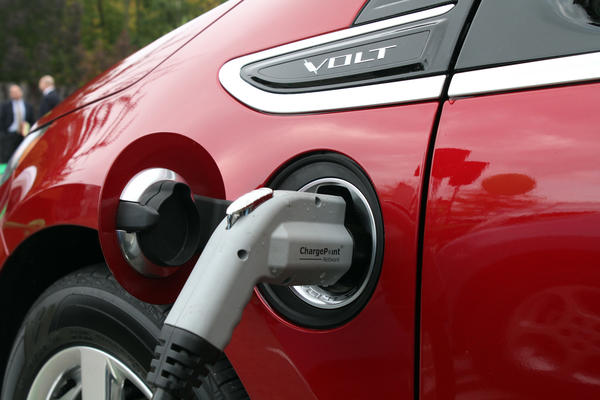 A plugged in Chevy Volt is being charged at an Aurora mall in September 2011. Now the tollway is adding charging stations.