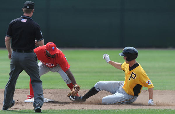 Philadelphia Phillies AAA (Lehigh Valley IronPigs) new infielder Joe Thurston (22) left, tags out Pittsburg Pirates AAA player Jordy Mercer (69) right, at second base in Clearwater FL. Thursday.