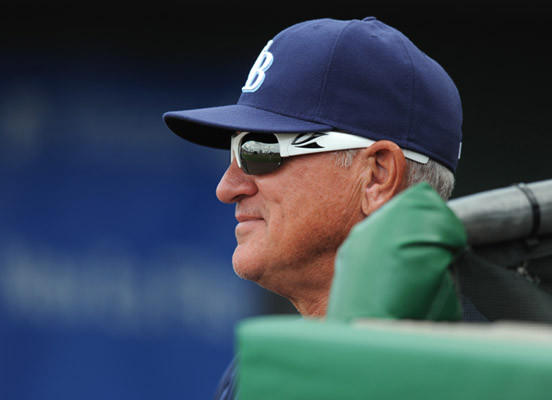 Tampa Bay Rays manager Joe Maddon watches the game from the dug out against the Philadelphia Phillies at Bright House Field in Clearwater FL, Thursday afternoon.