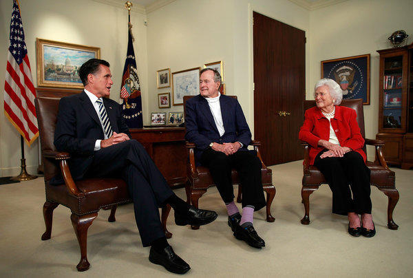 Mitt Romney meets with President George H.W. Bush and Barbara Bush at Bush's office on in Houston, Texas.