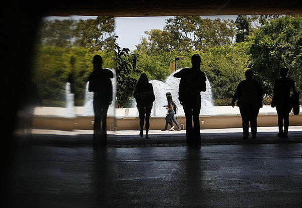 Students walk between Lough Memorial Fountain and Brotman Hall at Cal State Long Beach.
