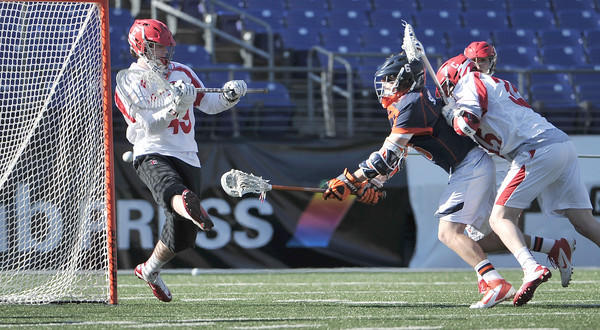 Virginia attackman Steele Stanwick (middle)