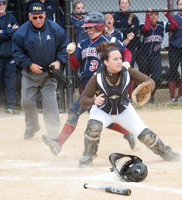 Liberty's Alyshia Dellatore (3) makes it safely home before the throw against Bethlehem Catholic catcher Taylor Brady (10) in the first inning of their game at Liberty High School on Thursday afternoon.