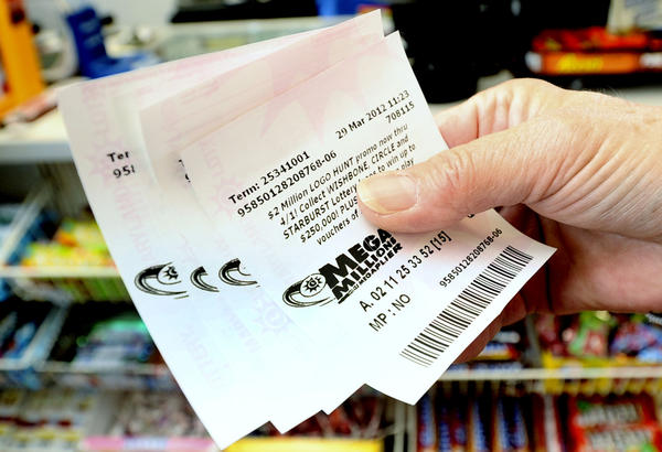 With the Mega Millions lottery jackpot at $640 million and climbing, the opportunity for a monster payout drew lines of people to local ticket outlets.