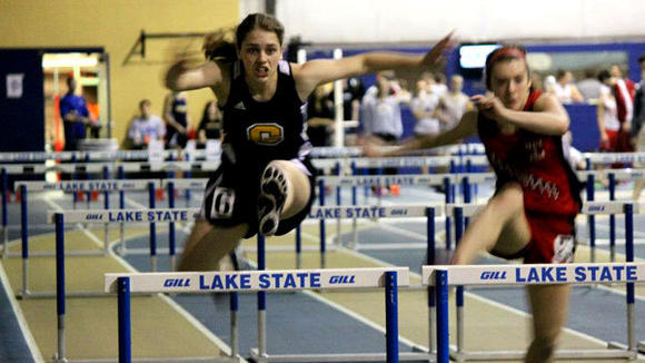 Gaylord's Andrea Mason extends over a hurdle at the Lake Superior State University high school classic. Mason finished fourth in the 55-meter hurdles.