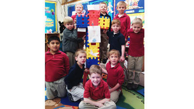 Kindergartners at St. Francis Xavier School with the waffle block cross are Luke Kendziorski (front, from left), Dane Smith, Shane Izzard, Max Faulkner; (back, from left) Korbin Sulitis, Lucas O'Donnell, Joey McCarthy, Aidan Cleary, Brian Pike and Tristan Goldsmith.