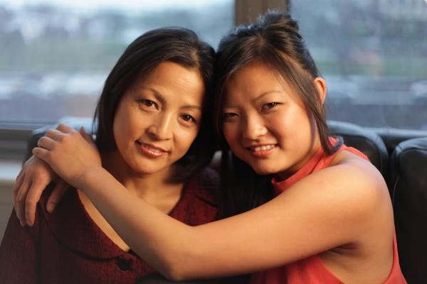 "Jian Ping (left) and Lisa Xia (right), subjects of the documentary ""Mulberry Child."""