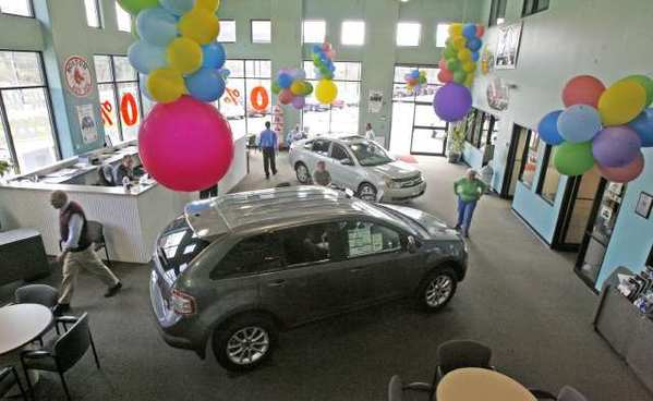 Car purchases helped push up consumer spending in February.