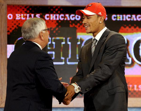Derrick Rose is congratulated by NBA Commissioner David Stern after being selected by the Bulls as the first pick overall in the 2008 draft.