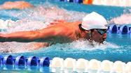 Phelps wins his preliminary heat in the 400 IM