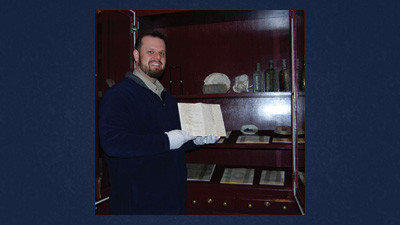 Benjamin Neely, director of Historic Collections for the Adams County Historical Society in Gettysburg, holds the letter written to Pvt. George Dull.