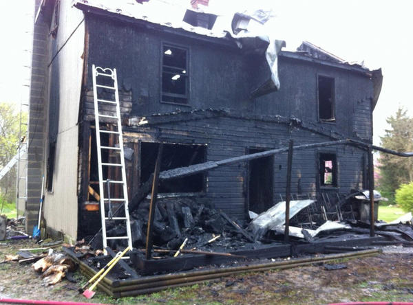 The charred remains of a two-story house at 182 Powell Lane in the Spring Mills, W.Va., area after Friday morning's fire.