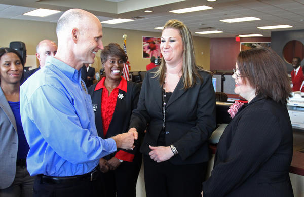 Gov. Rick Scott greets JobVantage employees after signing the workforce accountability bill during a ceremony in Orlando, Friday, March 30, 2012. The bill, HB 7023, empowers the governor to better regulate top executives of the state's regional jobs boards. The law came in the wake of a series of Orlando Sentinel stories that uncovered questionable spending and management practices during the past year at the boards, including Orlando's Workforce Central Florida. The workforce bill was part of the governor's ¿Job Creation and Economic Growth Agenda,¿ a package of four pro-business bills that he signed this week.