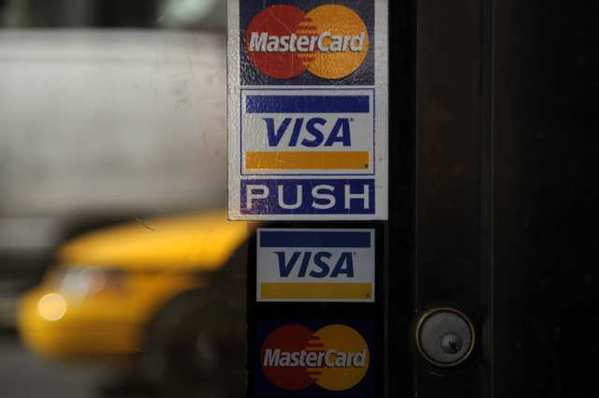 The Visa and MasterCard logos. Law enforcement officials are investigating what appears to be a massive theft of U.S. consumers' credit card data, MasterCard and Visa confirmed Friday.