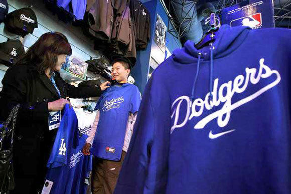Mika Murade, left, helps her son Riku shop for a Dodgers t-shirt in the Dodgers Clubhouse Store at Universal City Walk on March 28, 2012.