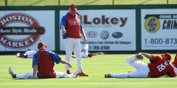 Philadelphia Phillies manager Charlie Manuel talks to Jonathan Papelbon left, and Laynce Nix right, during the morning work out at Bright House Field Thursday morning prior to their game with the Tampa Bay Rays.