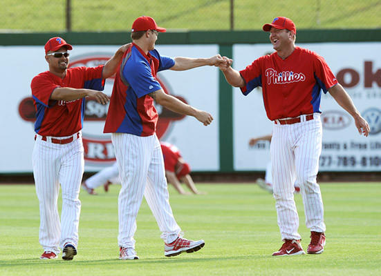 Philadelphia Phillies outfielder Shane Victorino left, and infielder Jim Thome right, joke around with pitcher Jonathan Papelbon during morning practice during spring training camp in Clearwater FL., Thursday.