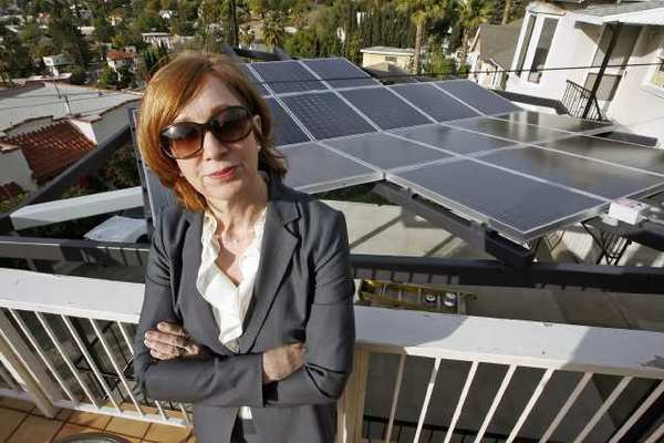 Glendale resident Connie Meisner stands on her deck overlooking a recently built solar panel structure on her neighbor's deck.